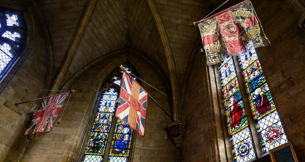 Military flags in St Saviour's Chapel at Norwich Cathedral (c) Bill Smith