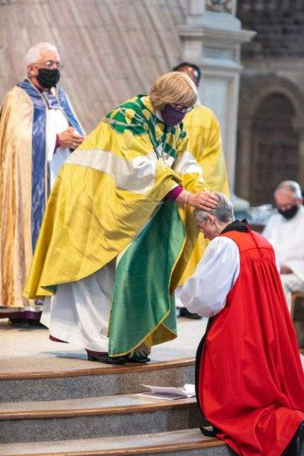 The Rt Revd Sarah Mullally Bishop of London lays hands on the new Bishop of Lynn (c) Diocese of Norwich