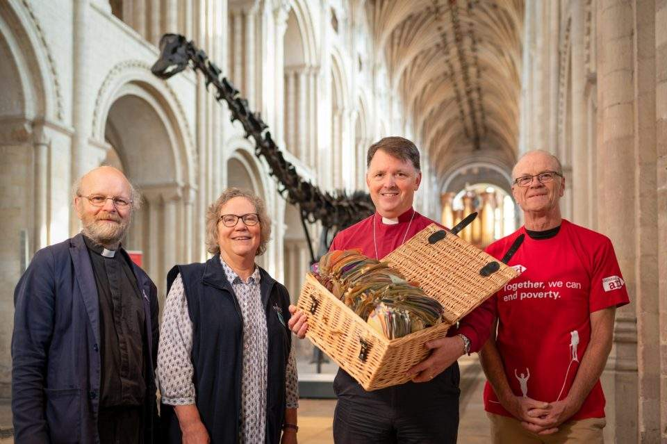 The Rt Revd Graham Usher, Bishop of Norwich, will deliver some of the 7000 pledges to protect the planet to COP26, inspired by Dippy the dinosaur's visit to Norwich Cathedral. Photograph: Norwich Cathedral/Bill Smith